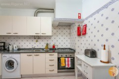 Kitchen with appliances and utility room / storage.