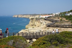 The boardwalk over the rocky coast starts at the end of the street opposite from you. End in the center of Carvoeiro with sandy beach, boat rental, restaurants, and cozy terraces.