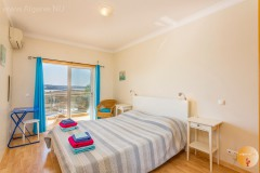 Large bedroom with balcony and air conditioning. Plenty of closet space, safe. Algarve. NOW
